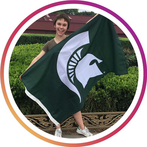 Instagram story circle of woman holding spartan helmet flag